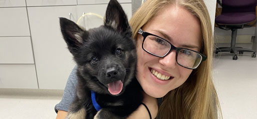 Woman hugging a small puppy